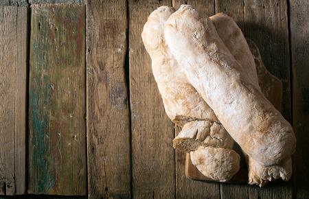 ciabatta: Crusty homemade Italian ciabatta bread on the wooden table