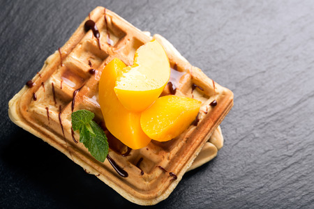 viennese: Viennese waffles with peaches and chocolate, decorated with mint