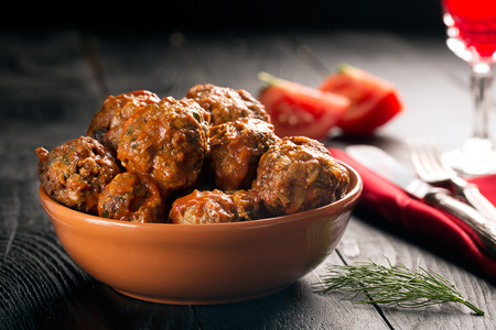 Meat balls in tomato sauce on a black background Stock Photo