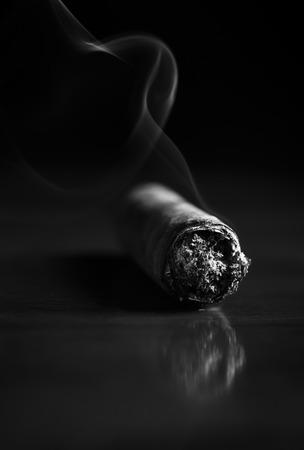 Fuming Havana cigar on a wooden table (b&w)