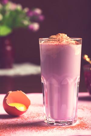 egg nog: Egg nog (Scottish egg cocktail) with cream, milk and raspberry syrup