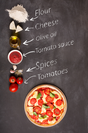 Ingredients for pizza on the chalkboard (tomatoes, cheese, sauce, water, spices, oil and flour). Reciepe of classical italian pizza