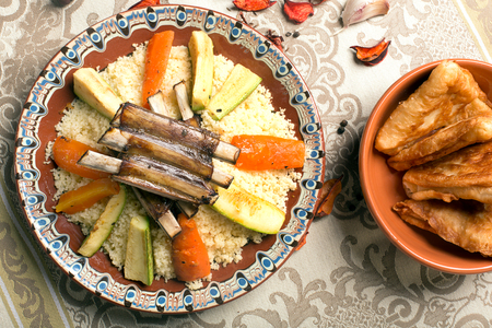 moroccan culture: Traditional couscous dish with lamb ribs and vegetables. Top view. The image is describing moroccan culture Stock Photo