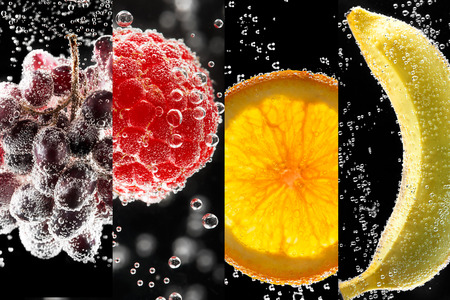 Fruits and berries (photo collage) surrounded by bubbles on the black background