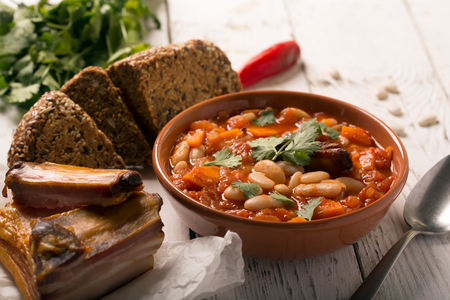 haricot: Rustic Kidney Bean Soup with beans and carrot. On the white wooden table