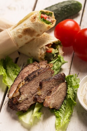 tzaziki: Doner kebab - fried beef meat with vegetables in tortilla