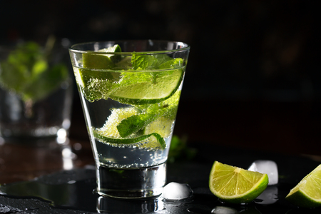 Mojito cocktail with lime and mint. Low key photo