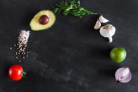 Guacamole ingredients on the dark chalkboard
