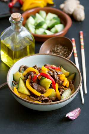 Traditional Asian stir fry salad contains meat and vegetables. Seasoned with soy sauce. Close up shot Stock fotó