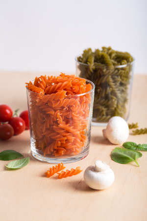 Different types of Italian pasta with vegetables on the table