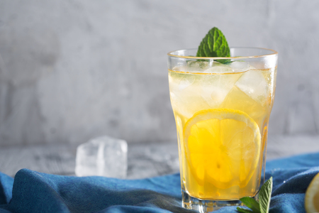 Glass of refreshing homemade lemonade with ice and mint. Horizontal orientation Imagens