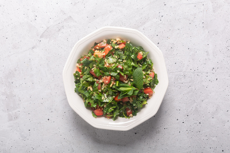 Tabbouleh salad is a traditional middle eastern or arab dish. Vegetarian salad with parsley, mint, bulgur, tomato. It can be eaten as food for iftar on Ramadan