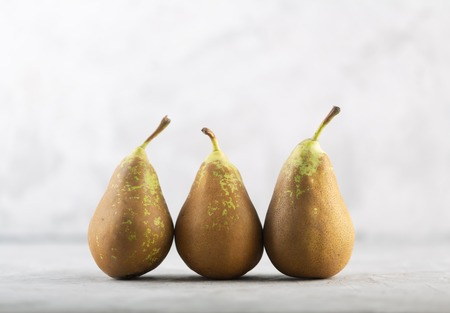 Ugly spotted pears on the gray background