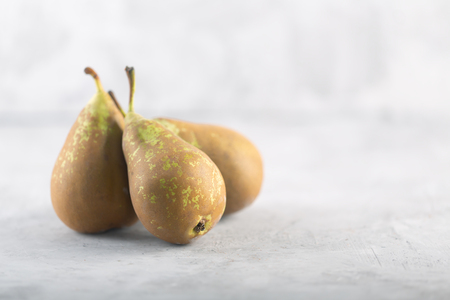 Ugly spotted pears on the gray concrete background
