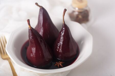 Poached pears in red mulled wine with cinnamon and anise