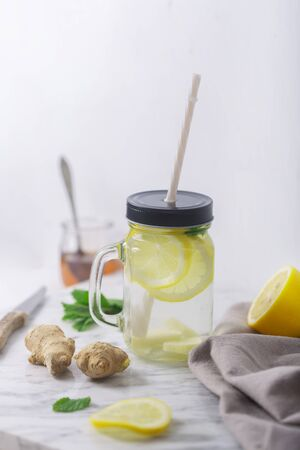 Ginger Water in Glass jar With Lemon and Honey, Vertical Orientation, White Background Stockfoto