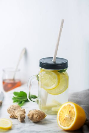 Ginger Water or tea in Glass jar With Lemon and Honey. This Drink is a Natural Anti-Inflammatory Agent That Acts as an Antioxidant and Improves Blood Sugar