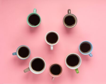 Coffee in the different cups on the pink background. Flatlay, cheerful day concept