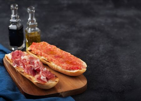 Spanish tomato and ham toast, traditional breakfast or lunch Stock Photo