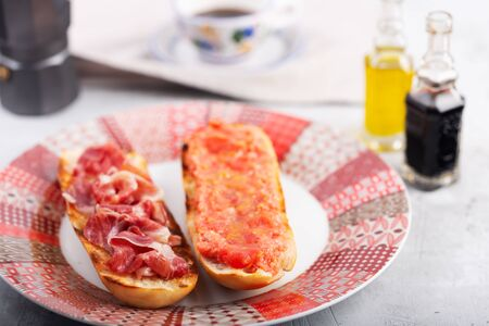 Spanish tomato and jamon toast close up, traditional breakfast or lunch