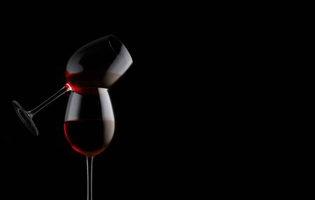 Red wine glass on black background with copy space. It provides antioxidants, can extend lifespan