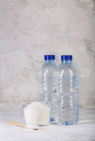 Collagen protein powder and two bottles of water - Hydrolyzed 스톡 콘텐츠