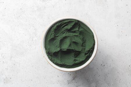 Chlorella single celled green algae. Detox superfood on the concrete background