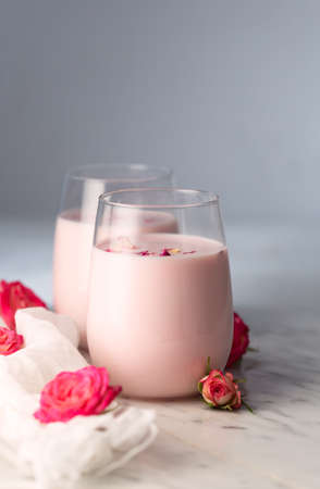 Rose moon milk for a better sleep. Ayurveda warm drink in glasses consumed before bed. Nice in case of sleeplessness, anxiety and insomnia