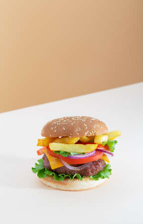 Fresh juicy beef hamburger placed on creative beige background with copy space, isometric vertical orientation