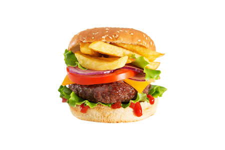 Fresh juicy beef hamburger with dripping ketchup and french fries isolated on white background