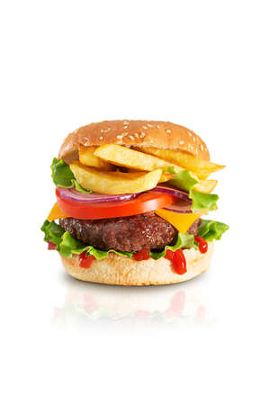 Fresh juicy beef hamburger with dripping ketchup and french fries isolated on white background with reflection