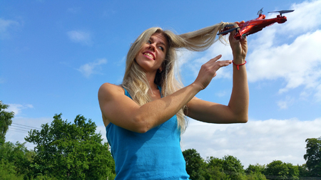 unkind: dissatisfied blonde woman with tangled hair drone