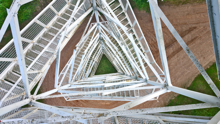metallic stairs: View from above through a metal lattice from the tower Stock Photo