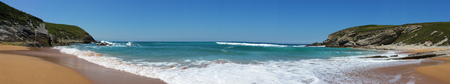 Beach with beautiful waves and blue sky, landscape. North Spain. Panoramic photo Stok Fotoğraf