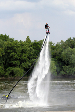 A man on a flyboard on the river. Stock Photo