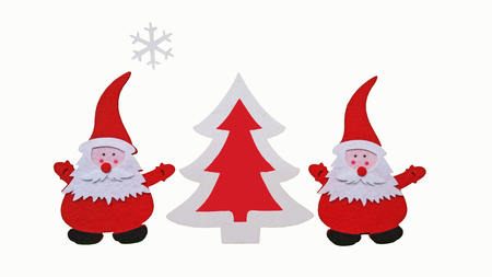 Drawing of Santa Claus and Christmass tree made of glued pieces of felt and plywood on a white background, hand-made Stock Photo