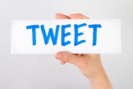 tweet: Hand showing tweet word