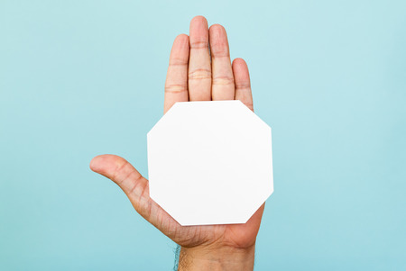 octagon: Stop hand and octagon shape on blue background Stock Photo