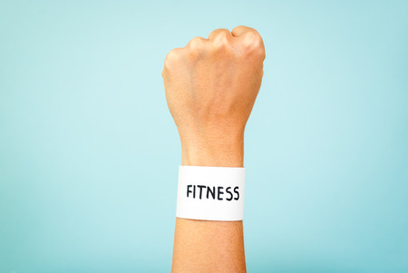manacle: Fitness woman hand concept on blue background Stock Photo