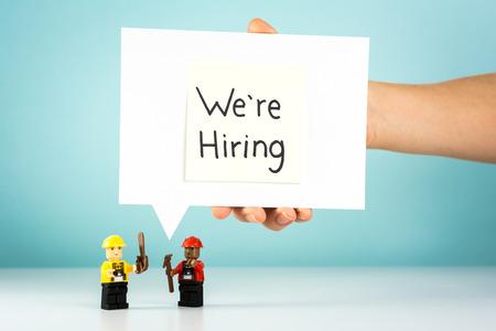 Manpower recruitment process concept on blue background Stock Photo