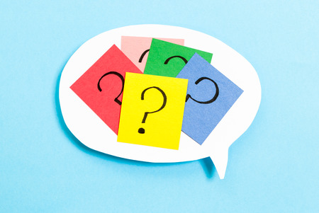 Thinking concept with question mark on blue background Stock Photo