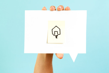 Homepage symbol on speech bubble with blue background Stock Photo