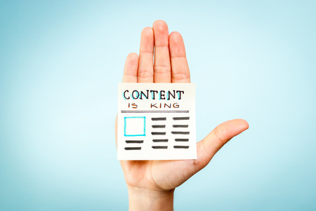 content writing: Hand with content is king message Stock Photo