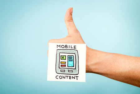 love strategy: Like mobile content concept on hand Stock Photo