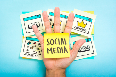 Social media on hand with blue background Archivio Fotografico