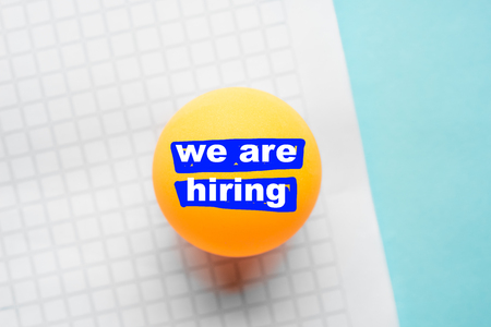 we are hiring illustrated message on yellow  ball and graph paper