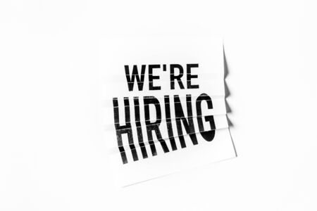 We are hiring text on paper folding poster with white background Stock Photo