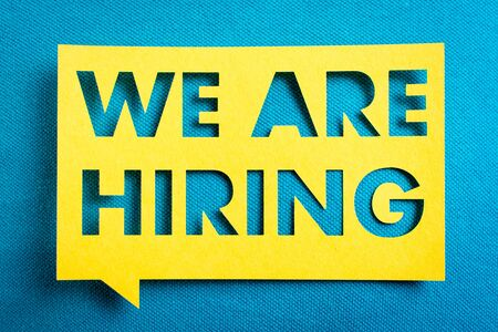 Concept of recruitment and job search. We are hiring yellow banner on blue textured background. Job board design, template.