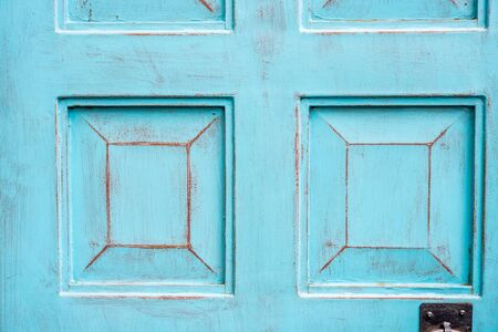 Close up background detail of vintage and rustic blue cyan wood door, with space for text