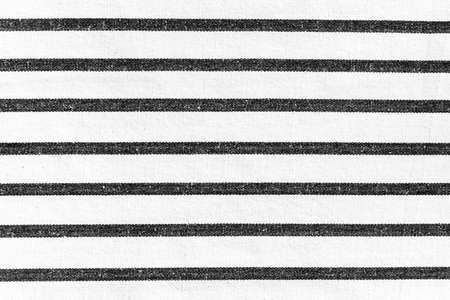 White rough fabric texture background with horizontal black lines striped pattern. Stock Photo